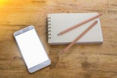 Dispositivo móvel usado para o planeamento empresarial e o começo incorporado novo fotografia de stock royalty free