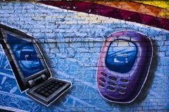 Dispositivos móveis da arte da rua foto de stock