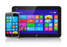 Dispositivos móviles con el interfaz de la pantalla táctil Imágenes de archivo libres de regalías