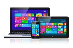 Dispositivos móviles con el interfaz de la pantalla táctil Fotos de archivo libres de regalías