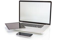 Dispositivos modernos del ordenador - ordenador portátil, PC de la tableta y smartphone Fotografía de archivo