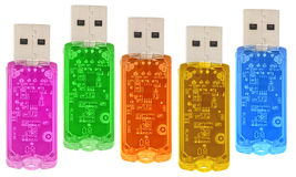 Dispositivos multicolor transparentes do USB isolados Fotos de Stock