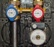 Dispositivos quentes e água fria Imagens de Stock