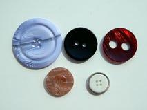 Disposizione dei bottoni per gli insiemi dell'abbigliamento Fotografia Stock