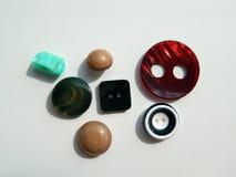 Disposizione dei bottoni per gli insiemi dell'abbigliamento Fotografia Stock Libera da Diritti