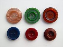 Disposizione dei bottoni per gli insiemi dell'abbigliamento Fotografie Stock Libere da Diritti