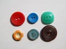 Disposizione dei bottoni per gli insiemi dell'abbigliamento Fotografie Stock