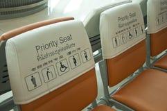 Disposizione dei posti a sedere di priorità nell'aeroporto Fotografie Stock Libere da Diritti