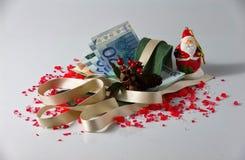 Disposizioni e soldi di Natale Immagini Stock Libere da Diritti