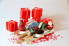 Disposizioni e soldi di Natale Fotografie Stock Libere da Diritti