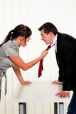 Dispute among employees at work in the office Royalty Free Stock Photo