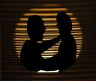 Dispute between two men. Silhouette of two men quarreling in the dark Royalty Free Stock Images