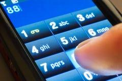 Disqu no smartphone do écran sensível fotografia de stock royalty free