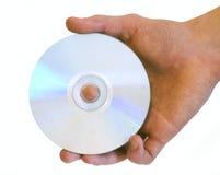 Disque de CD de la fixation DVD de la main de l'homme photo stock