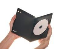 Disque de CD de la fixation DVD de la main des hommes Image libre de droits
