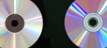 Disque de CD et de DVD sur le fond noir Photo libre de droits