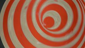 Disque rotatif avec l'illusion optique en parc banque de vidéos