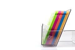 Disquetes coloridas em uma caixa transparente Fotografia de Stock Royalty Free