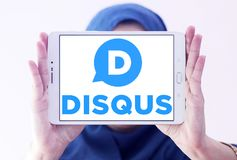 Disqus company logo. Logo of Disqus company on samsung tablet holded by arab muslim woman. Disqus is a worldwide blog comment hosting service for web sites and Stock Image