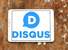 Disqus company logo. Logo of Disqus company on samsung tablet on wooden background. Disqus is a worldwide blog comment hosting service for web sites and online Royalty Free Stock Photos