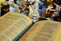 Disregard for the Bible, symbol. The Bible at the garbage, expressing the disregard for religious sayings and for God Royalty Free Stock Photos