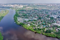 Disrict of private houses on bank of river. Tyumen Stock Photo