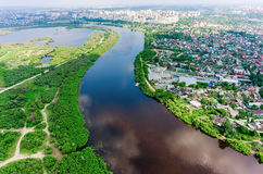 Disrict of private houses on bank of river. Tyumen Stock Image