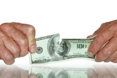 Disrupt Dollars. Human hands holding dispurt one hundred dollars banknote. Isolated with clipping path Stock Photos