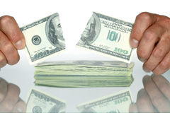 Disrupt Dollars. Human hands holding disrupt one hundred dollars banknote. Isolated with clipping path Royalty Free Stock Photos