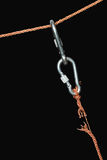 Disrupt Safety Equipment. Two connected carabiners hanging on the disrupt rope. Isolated on black with clipping path Royalty Free Stock Image