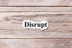 DISRUPT of the word on paper. concept. Words of DISRUPT on a wooden background royalty free stock photos
