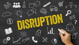 Disruption written on a blackboard. With icons Stock Images