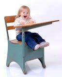 Disruptive Student. Toddler sitting at school desk Stock Photos