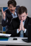 Dissagreemnet at work. Dissagreement between director and employee at work Stock Photo