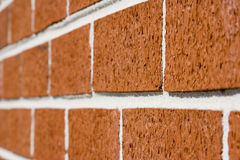 Dissapearing bricks. Red brick wall close up shot with selective focus drifting off to blurry Royalty Free Stock Photos