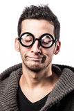 Dissapointed geek. Portrait of a dissapointed geek with funny glasses Royalty Free Stock Images