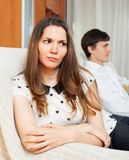 Dissapointed girl conflicting with boyfriend. At home Royalty Free Stock Photo