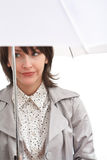 Dissapointed girl and umbrella. Dissapointed girl in grey coat under white umbrella Royalty Free Stock Images