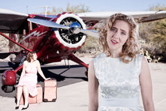 Dissapointed passengers. Two disappointed passengers next to a private plane Stock Image