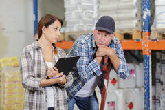 Dissapointed workers at warehouse. Dissapointed workers at a warehouse Stock Photo