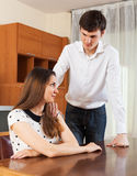 Dissapointed young couple having quarrel. At home Royalty Free Stock Photos