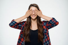 Dissapointed young girl covering her eyes. Over white background Royalty Free Stock Photography