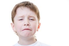 Dissapointment. A headshot of a dissapointed boy, isolated on white Stock Images