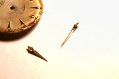 Dissasembled Watch. Old watch parts on parchment paper Royalty Free Stock Photo