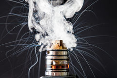 Dissassembled electronic Cigarette vape explosion. Vaporizer smoke explosion on isolated black background in studio royalty free stock photo