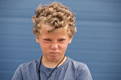 The dissatisfied. Portrait of the dissatisfied curly boy stock images
