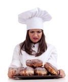 Dissatisfied or angry female chef wioth donuts Royalty Free Stock Photo