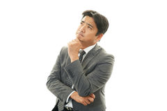 Dissatisfied Asian businessman Royalty Free Stock Photo