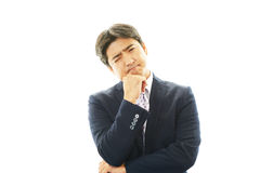 Dissatisfied Asian businessman Royalty Free Stock Images