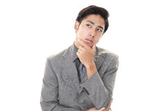 Dissatisfied Asian businessman Royalty Free Stock Image